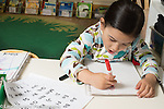Preschool 4 year olds art activity girl drawing with marker, talking to herself