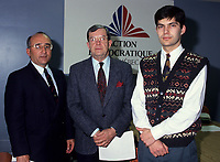 Unknown (L)<br /> Jean Allaire (M), leader<br /> Mario Dumont (R)<br /> Action démocratique du Québec (ADQ)<br /> in March 1994<br /> <br /> This party was founded in 1994 by Québec LIBERAL PARTY dissidents. After the rejection of the CHARLOTTETOWN ACCORD in October 1992, Mario Dumont, leader of the Young Liberals of Québec, and Jean Allaire a member of the executive committee of the Québec Liberal Party, left the Liberal Party when its members decided not to defend their platform proposition of 22 fields of exclusive jurisdiction claimed on behalf of Québec.<br /> <br /> The dissidents formed an initial amalgamation, le groupe de Réflexion Québec, followed in December 1993 by Action Québec. The (ADQ) party was founded only the following year, placing Mario Dumont, 23, the youngest party leader in Québec, at its head. The ADQ presented its first electoral platform on 5 and 6 March 1994, when 612 delegates from all the Québec regions adopted a Plan national de redressement (National recovery plan), bearing some twenty propositions aimed at elaborating an economic strategy and stabilizing government finances.<br /> <br /> In the September 1994 elections, the ADQ elected only a single candidate, Mario Dumont, in Rivière-du-Loup, but still obtained nearly 10 percent support of Quebec voters, even if it did not present candidates in all the electoral districts.<br /> <br /> In June 1995, Mario Dumont, Lucien BOUCHARD, then leader of the BLOC QUÉBÉCOIS, and Jacques PARIZEAU, leader of the PARTI QUÉBECOIS, signed an agreement that united these three parties within the Yes camp and partnered them for the formulation of the referendum question (see QUÉBEC REFERENDUM 1995).<br /> <br /> In the 30 November 1998 elections, only Mario Dumont was elected, again in Rivière-du-Loup, if the ADQ increased its percentage of support, by about 500 000 votes. The ADQ did not succeed in passing the critical voting threshold of 15 percent, making it a third party. However, the ADQ fought f