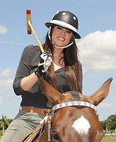 WEST PALM BEACH, FL - MARCH 14:  Kourtney Kardashian and Scott Disick with their young son Mason Dash Disick in tow take a polo lesson with top ranked american polo player Nic Roldan. The couple was joined by sister Khloe Kardashian. The kardashian clan had a great afternoon, riding horses and joking around while they sipped champagne at the International polo club palm beach on March 14, 2010 in Wellington, Florida.<br /> <br /> <br /> People:  Khloe Kardashian
