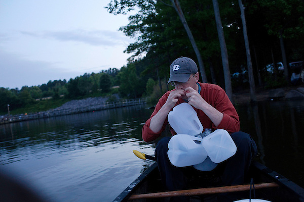 May 19, 2010. Chatham County, North Carolina.. Jug fishing is the art of tieing a baited hook and line to floating milk jugs and dropping the line into the water. After that, you just sit back and wait for the fish to bite, or not.. Lines are knotted to prepare the jugs for launch.