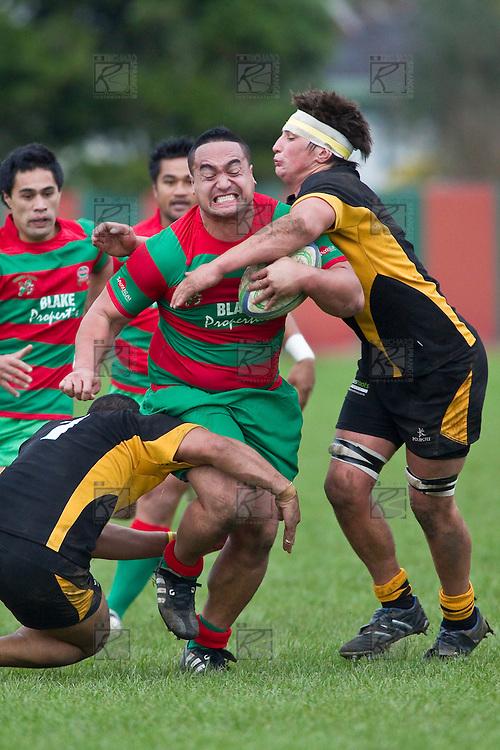 Ra Garmonsway looks to bust the tackle of Peter Mata and Liam Dunn. Counties Manukau Premier Club Rugby game between Waiuku and Bombay, played at Waiuku on Saturday July 5th 2010. Waiuku won 59 - 14 after trailing 12 - 14 at halftme.