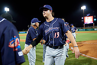 Jacksonville Jumbo Shrimp pitcher Dustin Beggs (19) high fives with his teammates after a game against the Pensacola Blue Wahoos on August 15, 2018 at Blue Wahoos Stadium in Pensacola, Florida.  Jacksonville defeated Pensacola 9-2.  (Mike Janes/Four Seam Images)