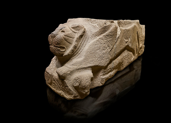 Alaca Hoyuk - Hittite lion sculpture corner Stone . Andesite. Alacahoyuk, 1399 - 1301 B.C. Anatolian Civilisations Museum, Ankara, Turkey.<br /> <br /> Corner stone with sculpted lion, bull and winged sun disk. It was discovered at the right side of the Alacahoyuk sphinx door. The lion puts his front legs on a small bull. There is a Hittite winged sun disk on the abdomen of the lion, which can be seen from a lower location. The position of the sun course indicates that the stone is situated in a high place.<br /> <br /> Against a black background.