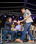 Michael Flatley reaches out to Martin Hayes after performing with the Tulla Ceili Band at the official opening of the All-Ireland Fleadh 2017 in Ennis. Photograph by John Kelly.