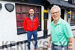 Aidan O'Connor of the Greyhound Bar stands outside the bar with  Neil O'Shea on Friday