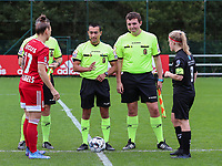 Captiain Maud Coutereels (17) of Standard, referee Mehdi Sayoud, assistant referee Romain Deltree and captain Jana Simons (8) of Woluwe at the coin toss before a female soccer game between Standard Femina de Liege and White Star Woluwe on the fifth matchday of the 2021 - 2022 season of Belgian Scooore Womens Super League , saturday 2 nd of October 2021  in Angleur , Belgium . PHOTO SPORTPIX   SEVIL OKTEM