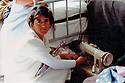Frnce 1989 Halat, sister of Mohammed Rashid  with her sewing machine in the military camp of Bourg-Lastic  France 1989  Jeune refugiée kurde au camp de Bourg-Lastic avec sa machine a coudre