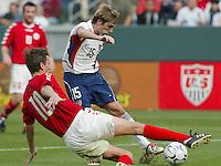 Per Nielsen, left, Bobby Convey, right, Denmark vs. USA, 2004.