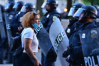 Washington, DC - June 1, 2020: A woman peacefully engages DC police a few blocks from the White House in Washington, DC  June 1, 2020, in the wake of the death of George Floyd by a Minnesota police officer.  (Photo by Don Baxter/Media Images International)