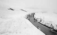 peloton (the 'bus'/'grupetto') up the snow-covered Colle dell'Agnello (2744m)<br /> <br /> stage 19: Pinerolo(IT) - Risoul(FR) 162km<br /> 99th Giro d'Italia 2016
