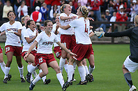 18 November 2007: Christen Press, Alicia Jenkins, Kristin Stannard, Kelley O'Hara, Shari Summers, and April Wall, congratulate Allison Falk and Alex Gamble during Stanford's 1-1 double overtime shootout win over California in the second round of the NCAA Division 1 Women's Soccer Championships at Laird Q. Cagan Stadium in Stanford, CA.