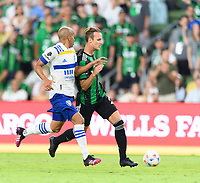 AUSTIN, TX - JUNE 19: Tomas Pochettino #7 of Austin FC and Judson Silva Tavares #93 of the SJ Earthquakes chase after a loose ball during a game between San Jose Earthquakes and Austin FC at Q2 Stadium on June 19, 2021 in Austin, Texas.