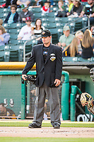 Home plate umpire Jordan Ferrell calls the plate between the Salt Lake Bees and the Sacramento River Cats game in Pacific Coast League action at Smith's Ballpark on April 20, 2015 in Salt Lake City, Utah.  (Stephen Smith/Four Seam Images)