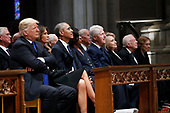 From left, President Donald Trump, first lady Melania Trump, former President Barack Obama, former first lady Michelle Obama, former President Bill Clinton, former Secretary of State Hillary Clinton, and former President Jimmy Carter and former first lady Rosalynn Carter, listen as former President George W. Bush speaks during a State Funeral at the National Cathedral, Wednesday, Dec. 5, 2018, in Washington, for former President George H.W. Bush. <br /> Credit: Alex Brandon / Pool via CNP