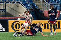 FOXBOROUGH, MA - AUGUST 21: Tiago Mendonca #33 of New England Revolution II tackles Ryley Kraft #98 of Richmond Kickers during a game between Richmond Kickers and New England Revolution II at Gillette Stadium on August 21, 2020 in Foxborough, Massachusetts.
