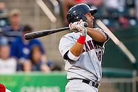 Jose Jimenez (38) of the Arkansas Travelers follows through his swing during a game against the Springfield Cardinals at Hammons Field on June 13, 2012 in Springfield, Missouri. (David Welker/Four Seam Images)