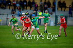 A tussle for possession between Kerrys Jackie Horgan and Courtney O'Keeffe of Cork in the Munster Junior Camogie semi final.