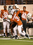 Texas A&M Aggies wide receiver Kenric McNeal (5) and Texas Longhorns cornerback Curtis Brown (3) in action during the Texas A & M vs. Texas Longhorns football game at the Darrell K Royal - Texas Memorial Stadium in Austin, Tx. Texas A & M defeats Texas 24 to 17....