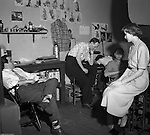 Pittsburgh PA:  Brady Stewart Studio staff listening to the McCarthy hearings on the radio.  Senator McCarthy chaired a Senate committee investigating the spread of communism throughout the government and private sector from 1950 to 1953.