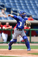 Dunedin Blue Jays catcher Derrick Chung (1) throws to first during a game against the Clearwater Threshers on April 6, 2014 at Bright House Field in Clearwater, Florida.  Dunedin defeated Clearwater 5-2.  (Mike Janes/Four Seam Images)