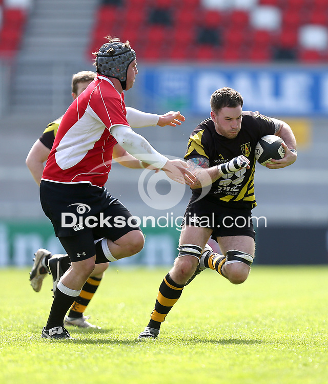 2014 McCAMBLEY CUP FINAL - Ards 4 vs Cookstown | Saturday 26th April 2014<br /> <br /> Chris Moore is tackled by Keith McIlwaine during the 2014 McCambley Cup Final between Ards 4's and Cookstown at Ravenhill Stadium, Belfast.<br /> <br /> Mandatory Credit - Photo by John Dickson - DICKSONDIGITAL