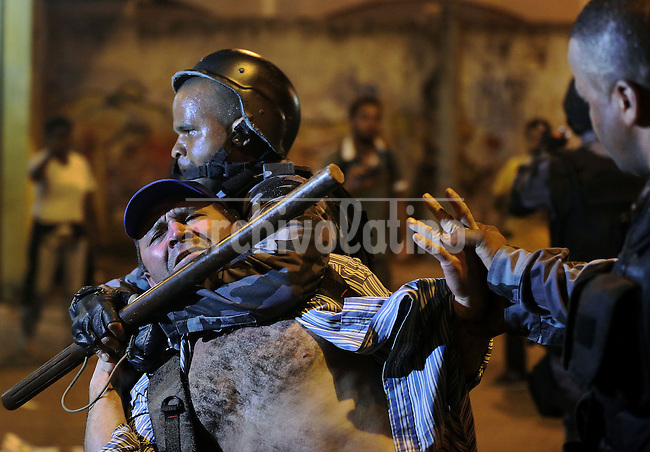 A man is arrested during riots on the streets of Rio, in front of the City Hall, Rio de Janeiro, Brazil, June 20, 2013. The people of this movement protest against official corruption and spending on next year's World Cup. (Austral Foto/Léo Corrêa)