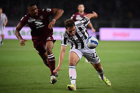 Gleison Bremer of Torino Calcio and Federico Chiesa of Juventus FC compete for the ball during the Serie A 2021/2022 football match between Torino FC and Juventus FC at Stadio Olimpico Grande Torino in Turin (Italy), October 2nd, 2021. Photo Federico Tardito / Insidefoto