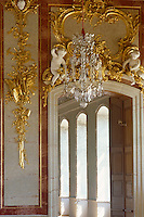 The work of master gilder Johann Endres frames a doorway leading from the throne room