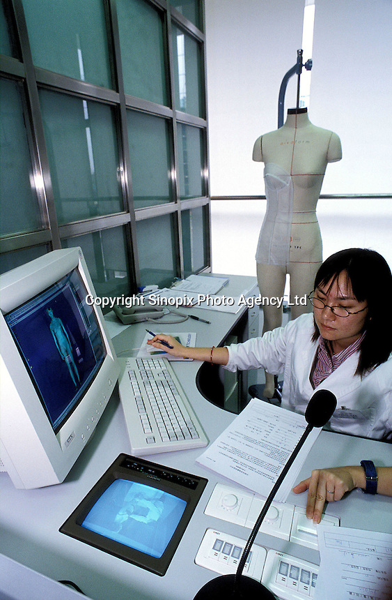 Professional fitting designers use the latest technology at the technology centre of Bra City in Foshan China...PHOTO BY SINOPIX