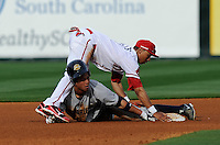 Second baseman Robert Refsnyder (15) of the Charleston River Dogs gets tangled up with second baseman Mookie Betts (7) of the Greenville Drive after sliding into second with a double in the fifth inning of a game on Saturday, April 6, 2013, at Fluor Field at the West End in Greenville, South Carolina. Charleston won Game 1 of a doubleheader, 6-2. (Tom Priddy/Four Seam Images)