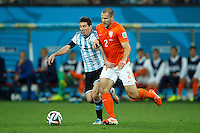 Ron Vlaar of the Netherlands and Lionel Messi of Argentina