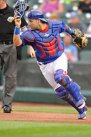 Rafael Lopez #29 of the Iowa Cubs chase a wild pitch against the New Orleans Zephyrs at Principal Park on July  24, 2014 in Des Moines, Iowa. The Cubs won 11-2.   (Dennis Hubbard/Four Seam Images)