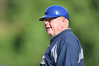 Asheville Tourists development supervisor Marv Foley (13) coaches first base during a game against the Columbia Fireflies at McCormick Field on June 18, 2016 in Asheville, North Carolina. The Tourists defeated the Fireflies 5-4. (Tony Farlow/Four Seam Images)
