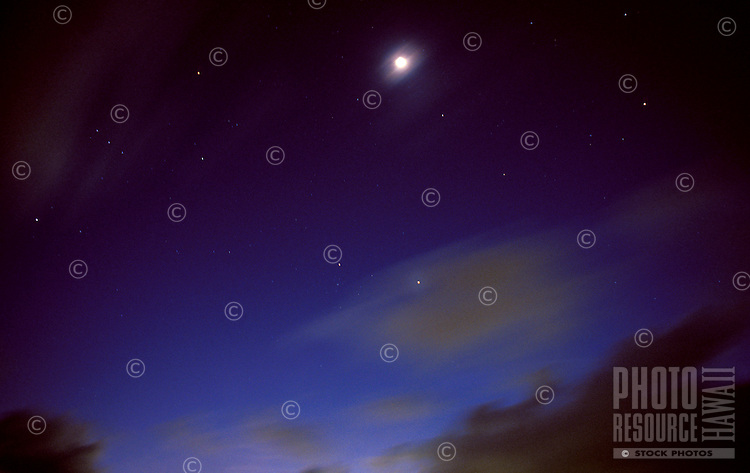 Amazing night scene with full moon and brilliant stars on a deep blue sky.
