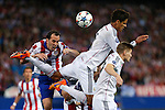 Atletico de Madrid's Diego Godin (L) and Real Madrid´s Raphael Varane and Toni Kroos during quarterfinal first leg Champions League soccer match at Vicente Calderon stadium in Madrid, Spain. April 14, 2015. (ALTERPHOTOS/Victor Blanco)