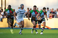 20130803 Copyright onEdition 2013 ©<br />Free for editorial use image, please credit: onEdition.<br /><br />Ollie Lindsay-Hague of Harlequins 7s accelerates away from Juiliano Fiore of London Irish 7s during the J.P. Morgan Asset Management Premiership Rugby 7s Series.<br /><br />The J.P. Morgan Asset Management Premiership Rugby 7s Series kicks off for the fourth season on Thursday 1st August with Pool A at Kingsholm, Gloucester with Pool B being played at Franklin's Gardens, Northampton on Friday 2nd August, Pool C at Allianz Park, Saracens home ground, on Saturday 3rd August and the Final being played at The Recreation Ground, Bath on Friday 9th August. The innovative tournament, which involves all 12 Premiership Rugby clubs, offers a fantastic platform for some of the country's finest young athletes to be exposed to the excitement, pressures and skills required to compete at an elite level.<br /><br />The 12 Premiership Rugby clubs are divided into three groups for the tournament, with the winner and runner up of each regional event going through to the Final. There are six games each evening, with each match consisting of two 7 minute halves with a 2 minute break at half time.<br /><br />For additional images please go to: http://www.w-w-i.com/jp_morgan_premiership_sevens/<br /><br />For press contacts contact: Beth Begg at brandRapport on D: +44 (0)20 7932 5813 M: +44 (0)7900 88231 E: BBegg@brand-rapport.com<br /><br />If you require a higher resolution image or you have any other onEdition photographic enquiries, please contact onEdition on 0845 900 2 900 or email info@onEdition.com<br />This image is copyright the onEdition 2013©.<br /><br />This image has been supplied by onEdition and must be credited onEdition. The author is asserting his full Moral rights in relation to the publication of this image. Rights for onward transmission of any image or file is not granted or implied. Changing or deleting Copyright information is illegal as specified in the Cop