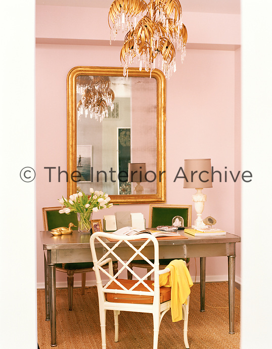 Calm, muted tones blend seamlessly in this serene office corner with a signature dusky pink wall.