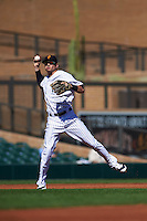 Surprise Saguaros shortstop Tyler Wade (12) throws to first during an Arizona Fall League game against the Glendale Desert Dogs on October 23, 2015 at Salt River Fields at Talking Stick in Scottsdale, Arizona.  Glendale defeated Surprise 9-6.  (Mike Janes/Four Seam Images)