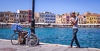 Travel Art Print Photograph. of the colourful picturesque port of Chania, Crete, Greece.<br /> Seaside image of a bicycle leaning against a lamp pole and the colourful buildings surrounding the port city.