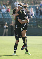 Christine Sinclair (left) hugs with Tiffany Weimer (right) after her goal. Washington Freedom defeated FC Gold Pride 4-3 at Buck Shaw Stadium in Santa Clara, California on April 26, 2009.