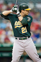 Oakland Athletics third baseman Andy LaRoche (21) at bat against the Texas Rangers in American League baseball on May 11, 2011 at the Rangers Ballpark in Arlington, Texas. (Photo by Andrew Woolley / Four Seam Images)