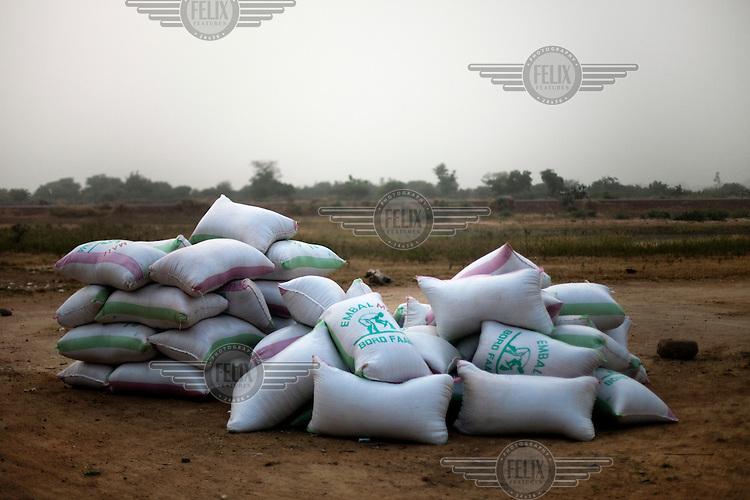 Sacks from Embal Mali await collection in Karaba.