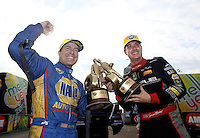 Mar 15, 2015; Gainesville, FL, USA; Funny car winner Ron Capps (left) and NHRA top fuel driver Spencer Massey celebrate together after winning the Gatornationals at Auto Plus Raceway at Gainesville. Mandatory Credit: Mark J. Rebilas-
