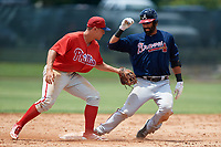 Philadelphia Phillies Brian Mims (9) reaches out to tag Jose Bautista (1) during a Minor League Extended Spring Training game against the Atlanta Braves on April 20, 2018 at Carpenter Complex in Clearwater, Florida.  (Mike Janes/Four Seam Images)