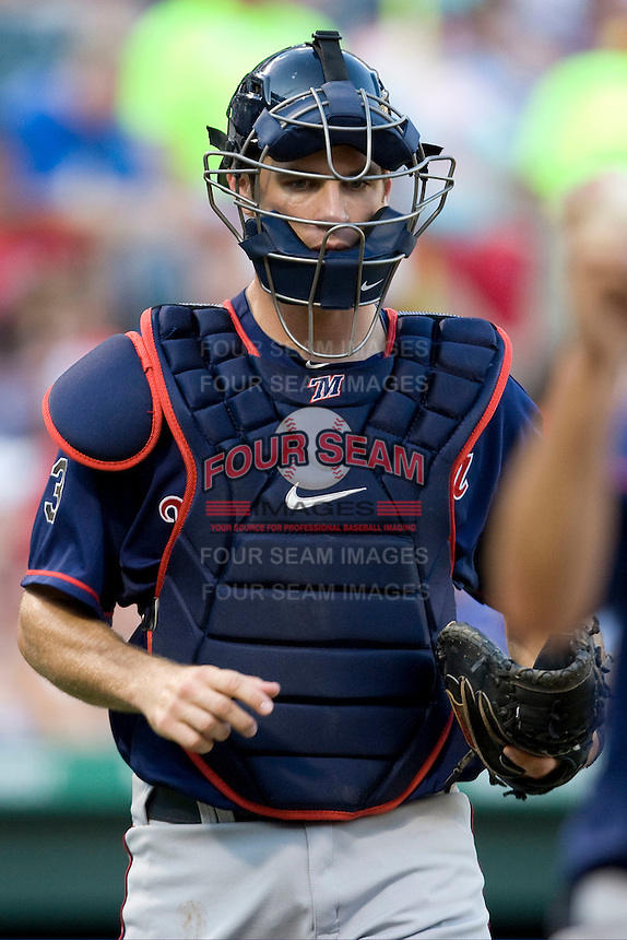 Minnesota Twins catcher Joe Mauer #7 trots out to his position during a Major League Baseball game against the Texas Rangers at the Rangers Ballpark in Arlington, Texas on July 27, 2011. Minnesota defeated Texas 7-2.  (Andrew Woolley/Four Seam Images)