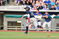 Mississippi Braves second baseman Ozzie Albies (20) runs to first base during a game against the Tennessee Smokies at Smokies Stadium on July 23, 2016 in Kodak, Tennessee. The Braves defeated the Smokies 3-0. (Tony Farlow/Four Seam Images)