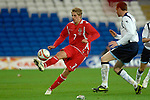 International Friendly match between Wales and Scotland at the new Cardiff City Stadium : David Edwards of Wales chips the ball.