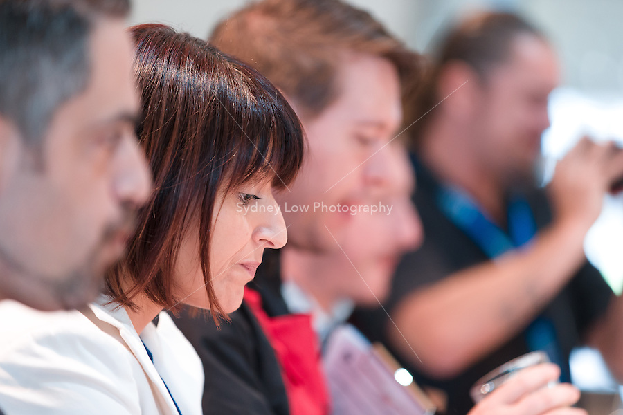 March 15, 2015: Judges evaluate Aaron Wood in the 2015 Australian Barista Championships at the Showgrounds, Melbourne, Australia. Photo Sydney Low.