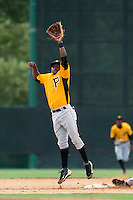 GCL Pirates second baseman Jodaneli Carajal #5 attempts to catch an errant throw during a game against the GCL Braves at Disney Wide World of Sports on June 25, 2011 in Kissimmee, Florida.  The Pirates defeated the Braves 5-4 in ten innings.  (Mike Janes/Four Seam Images)