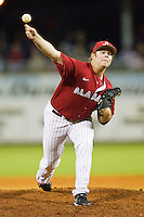 Relief pitcher Brett Whitaker #7 of the Alabama Crimson Tide in action against the Auburn Tigers at Riverwalk Park on March 15, 2011 in Montgomery, Alabama.  Photo by Brian Westerholt / Four Seam Images